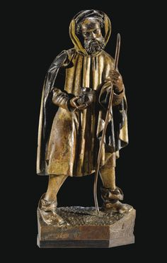 A FLEMISH, PROBABLY ANTWERP, 16TH CENTURY, GILT AND POLYCHROMED OAK HIGHT RELIEF PILGRIM ; ON A LATER WOOD BASE