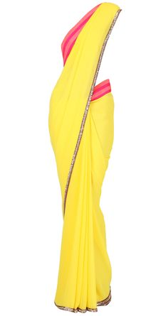 Yellow georgette Sari with neon pink and coral striped border and golu's by MANISH MALHOTRA.