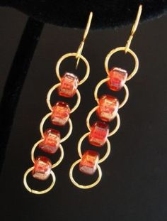 Bead chain earrings  #handmade #jewelry #beading\/Not so much as earrings but I think it would look great turned sideways and layered like a bib necklace.