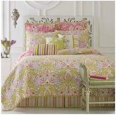 """Moroccan Garden Quilt - Bed/Bath & Beyond - $150 - reversible quilt has an exotic print with vibrant colors to give your bed a fresh and fun look. The pink and green quilt features outline quilting and a pleated ruffle border. 100% cotton. Twin quilt measures 68"""" W x 86"""" L, Full/Queen is 90"""" W x 90"""" L and King is 104"""" W x 90"""" L. Machine wash. Imported. Coordinating accessories available separately."""
