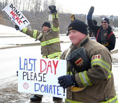Members of St. Albert Fire Services celebrate as another car pulls over to donate money to Muscular Dystrophy Canada outside Fire Station No. 2