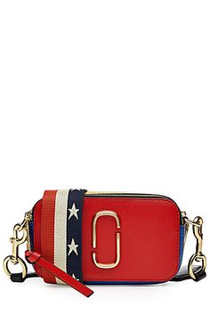 Spring '16 saw Jacobs' runway take place at the famous Ziegfeld theater, a New York institution and a fitting backdrop to the America-themed cinema-inspired show. This colorblock shoulder bag is a representative accessory, complete with camera-like silhouette and a stars-and-stripes fabric strap #Stylebop