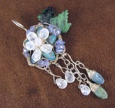 Wire wrapped sterling silver, kyanite, moonstone flower pendant