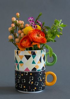 Flowers in mugs...always a good idea!