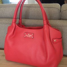 Kate Spade Handbag Gorgeous NWT Kate Spade Stevie Berkshire Road Geranium handbag in a coral/pink/red color. Zipper closure with two pockets and a zipper pocket on the inside. The perfect purse for spring and summer! kate spade Bags Shoulder Bags