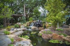 backyard oasis with pond and waterfalls, gardening, outdoor living, ponds water features, An ecosystem pond sets the stage for peace and relaxation