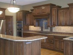 Custom maple cabinets finished in a walnut stain and then a black ...