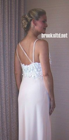 assymetrical detail on silk and quipere lace, interesting back, designed by Brooks Luby