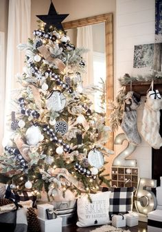 bold black and white Christmas tree decor, plaid monochrome textiles