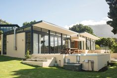 House in Cape Town, South Africa. Amazing glass, steel and concrete single storey house with plunge pool, terraces and lawn, beautiful walled irrigated gardens and spectacular views of mountains and sea.  The house is in a quiet secure residential area, within easy driving distanc... - Get $25 credit with Airbnb if you sign up with this link http://www.airbnb.com/c/groberts22