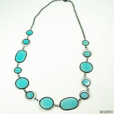 """I love the translucent color of this necklace (and the matching earrings).  This necklace says, """"I am in charge; I make wise decisions...""""  Sibuyan Sea Capiz Necklace Delicate pale blue capiz shell discs create dramatic jewelry pieces. Lead- and nickel-free black-plated wire and hooks #serrv #fairtrade #giftswithpurpose"""