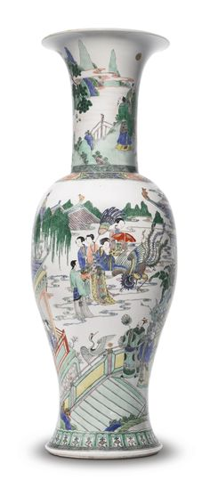 LARGE FAMILLE-VERTE 'PHOENIX-TAIL' VASE, QING DYNASTY, 18TH / 19TH CENTURY, the baluster-form rising to a trumpet mouth with everted rim, painted with a continuous scene depicting the immortal Xiwangmu with female attendants, set within the lush paradisiacal home of the deity, Mount Kunlun, the base with a Chenghua cyclical date within a double circle, Height 30 3/4  in.