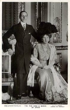 "King Alfonso XIII and Queen Victoria Eugenie of Spain. Victoria Eugenie was a carrier of the blood disease haemophilia. Born as princess Victoria Eugenie of Battenberg she was a granddaughter of Queen Victoria of England. The spanish people fell for her beauty, and nicknamed her ""La Reina Hermosa"" (=the beautiful queen). Her grandson Juan Carlos is the present king of Spain."