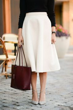 Chic white skirt, burgundy tote bag and grey strapped heels.