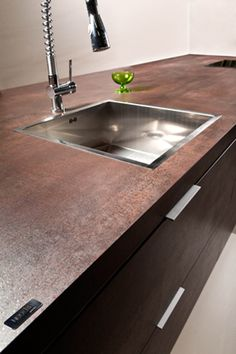 NEOLITH Countertop (Iron Corten, #IronCollection). 100% natural, hygienic, lightweight, waterproof, eco-friendly, durable and easy to clean.  #Neolith #NeolithKitchen