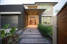 Interesting frontage, lovely grand entrance, large eaves, stone entrance, lighting at entrance, warm.