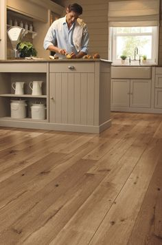 Quick-Step Laminate --- Really like the neutral colors of this #kitchen. Like the colour of the laminate.