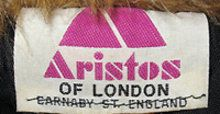 Aristos label from a late 1960s velvet suit - Aristos Constantinou opened his Aristos boutique on Carnaby Street in 1966. In 1971, he was joined by his brother Achilleas and together they formed Ariella Fashions Limited. Hence the label being 'designed by Aristos'. They expanded from these premises into Duke Street, Oxford Street, Newburgh Street and more on Carnaby Street. In the 1970s, Punch Magazine described them as 'the power of Carnaby Street'.