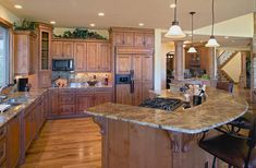 Colorado Style Kitchen with granite raised bar island and hickory cabinets