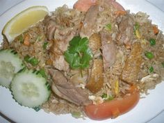 Duck Fried Rice :Stir-fried rice with duck, egg, onion, tomatoes, peas, and carrots. #Rich #egg #Awesome Thai #Food forked.com