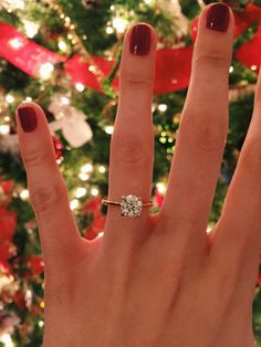 Engagement photo idea - round solitaire engagement ring with thin gold band