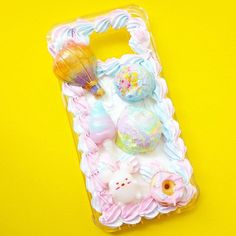 One of my favourite decoden cases so far; this fits a samsung S7 edge and can be purchased on our website. #cabochons #cabochon #decoden #polymerclaycharm #polymerclay #hotairballoon #icecream #cuteart #cottoncandy #パステル #miniatures #queequeg #donut #フード #birthdaycake #スイーツデコ #icing #sweetsdeco #キャンディ#kawaiiart #frosting #clayart #whippedcream #cutephone #アイシングクッキー #クッキー #pastel #かわいい #cutephonecase #samsung