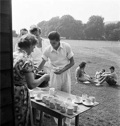 Cricket Tea interval, Lewes, East Sussex.  A woman serves tea during the tea interval at a cricket match at thet Whitsun fair near Lewes in 1959.