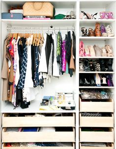 The organized closet with lower drawers, shoe shelves, space to hang clothes and more.  Very efficient neat closet. http://cococozy.com