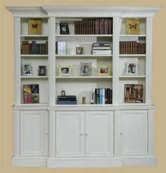 Beautiful Bookcases- tip is to have books on one shelf and accessories on another.