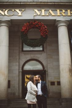The bride and groom kissing in front of Faneuil Hall in Boston, Massachusetts | Wedding Photography