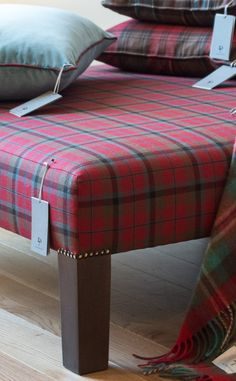 Traditional Tartan Footstool Combining a solid wooden frame, sturdy bronze studs and a gorgeous D C Dalgliesh tartan - this upholstered footstool is the ultimate interior piece.  Designed to complement sofas, cushions, and throws.  Wonderfully solid and comfortable home accessory.