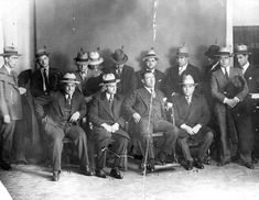 Fourteen Sicilian mobsters arrested at the first known national meeting of the Mafia held in Cleveland in 1928, and hosted by Cleveland mob boss Joe Porrello. Notable are Joseph Profaci (seated in wheelchair), head of what would become New York City's Colombo crime family. Flanking Profaci are Capone representatives Joseph Giunta on the left and Pasquale Lolordo.