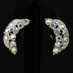 Light up your evenings with glittering crescent earrings by Bogoff that outline your ears in flashing aurora borealis rhinestones. Clip earrings measure approximately 1/2 inch wide and about 1-1/8 inc