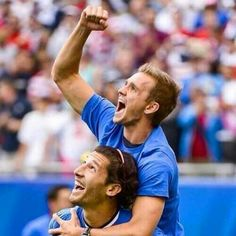 Omar Gonzalez carrying Stu Holden during the Gold Cup 2013 victory lap after Holden torn his ACL during the Championship Game.
