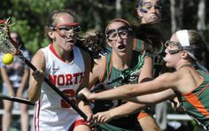 NORTH ATTLEBORO - It was a day of historic proportions on the upper fields at North Attleboro High School on Tuesday in the first MIAA Girls' Lacrosse Tournament match ever hosted by the Rocketeers.