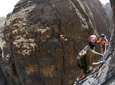 Photo: Hikers on rocks in Oman