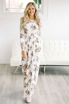 The perfect fall and winter maxi dress! Beautiful, soft and comfortable, The Alexa is a must have. Beautiful ivory dress features a peach and sage floral print, long sleeves, round neckline, elastic waist and side seam pockets.