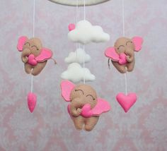 """100% hand made of high quality soft felt, stuffed with non-allergic hollofayber. Hoop covered with felt and decorated with felt hearts. Elephant height 3"""", width 4"""" Hoop diameter approx. 8""""/ 20..."""