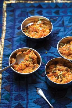From SAVEUR Issue #167 Studded with chopped nuts and flavored with aromatic cardamom and rose water, this sweet Indian pudding is made from a blend of nutty ghee, milk, cream, sugar, and grated carrot.