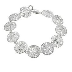 @Overstock - Add to your personal style with this sterling silver sand dollar jewelry  Bracelet features a textured sand dollar design with a high polish finish   Simple yet stylish bracelet makes the perfect gifthttp://www.overstock.com/Jewelry-Watches/Sterling-Silver-Sand-Dollar-Link-Bracelet/3401982/product.html?CID=214117 $19.49