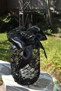 Black Lace Wrapped Mason Jar w Lush Satin Ribbon Bow With Glass Votive Candle Insert. via Etsy. Adding to my ideas for how to turn my year round decor (such as mason jars and vases) into elegant gothic Halloween decor. This is brilliant! Glass Votive, Votive Candles, Lace Candles, Halloween Wedding Centerpieces, Black Centerpieces, Halloween Weddings, Halloween Wedding Dresses, Lace Wrap, Mason Jar Crafts