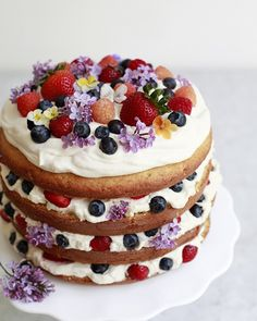 Fruit and edible flowers make this Bailey's Tres Leches Cake dessert perfection.