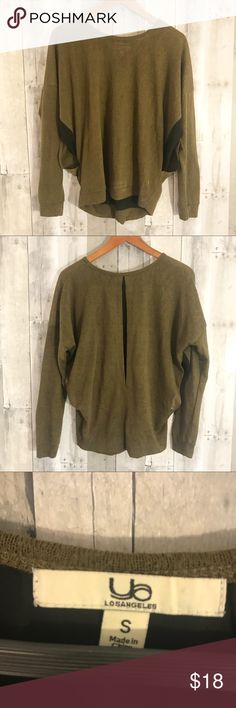 Army Green Sheer Back Long Sleeve This is a perfect piece for winter! It's a warm, army green long sleeve with little cut outs on the side and back that have black sheer paneling. It's great to wear for a nice evening out, and spices up any comfortable casual outfit! Fits size small to medium, and in great condition! Please feel free to ask questions, comment, or offer! *Purchased from a local boutique called Ooh La La. Ooh La La Tops