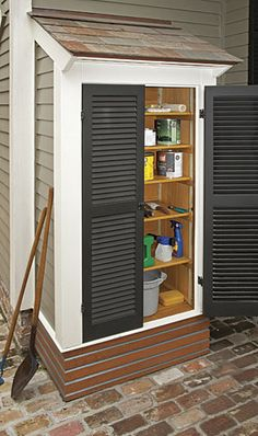 Outdoor shed with shutters built right next to the house