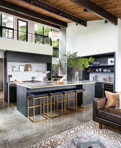 The entry segues into the open kitchen and living space. The second-floor mezzanine was once enclosed. By removing its walls, the architects brought in more light and a better connection to the… Modern Kitchen Design, Interior Design Kitchen, Modern Interior Design, Modern Decor, Interior Decorating, Decorating Kitchen, Decorating Games, Decorating Websites, Interior Architecture