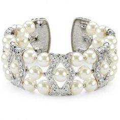 """This traditional mix of champagne pearls and crystals is set on a cuff style bracelet so the look is still modern. Each bracelet measures approximately 1.5"""" wide."""