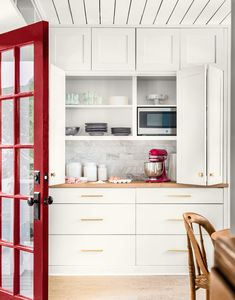 Added pantry: A smartly painted front-facing French door opens onto a new multipurpose space with cabinets that catch spillover from the kitchen. Ceiling planks echo the original shiplap walls. The floor is cork. Kitchen Pantry Design, Kitchen Nook, Kitchen Reno, Kitchen Remodel, Kitchen Cabinets, Kitchen Units, Kitchen Ideas, Open Pantry, Dining Nook
