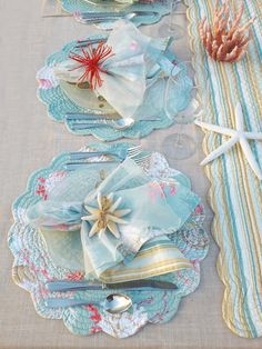 Glorious aqua blue water with bright shells and sandy undertones, Santa Catalina quilt is a timeless coastal pattern for your coastal retreat. Reverse of placemats, napkins and runners is our Natural Stripe print in aquas and taupe.