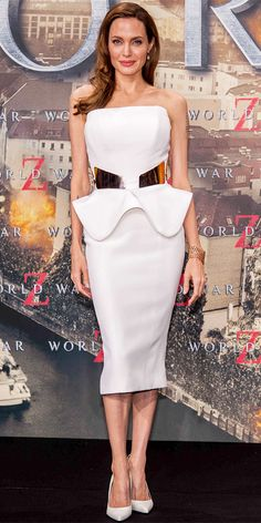 06/05/13: At the Berlin World War Z premiere, Angelina Jolie worked her curves in a belted Ralph & Russo peplum dress. Rose gold jewelry and leather stilettos completed the look. #lookoftheday