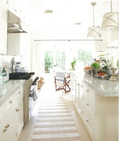 Mark D Sikes, the traditional white on white kitchen with cotton stripe rugs and visual comfort lighting